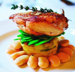 An image showing a Breast of Chicken with Madeira Wine Sauce with a Splash of Cream, Fresh Vegetables and Boulangere Potato
