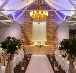 an image showing one of their function room all beautifully decorated before a wedding ceremony is due to take place