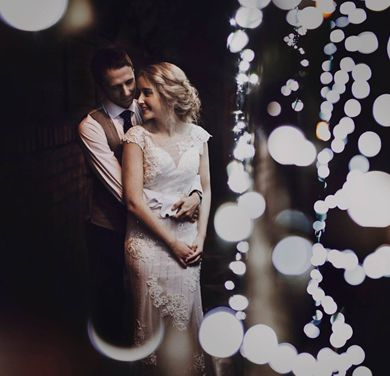 A bride and Groom photo holding hands - Starry Night Wedding