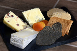 A close up image showing a cheeseboard