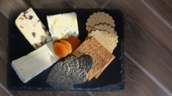 A overhead image taken of a cheeseboard served at the Nest Restaurant