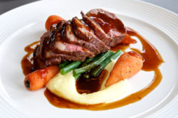 An image showing a plate of Port Fillet with Mash Potato, Carrots served with a puree sauce