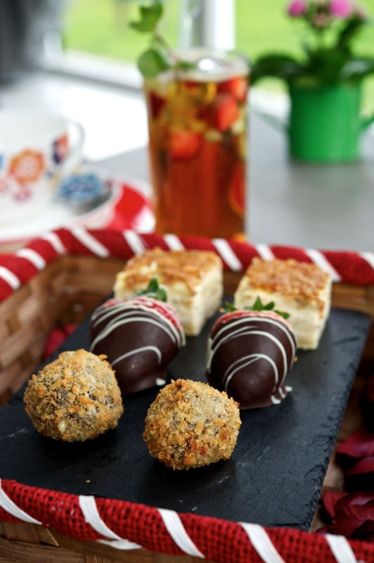 a selection of six small delicious cakes on a tray