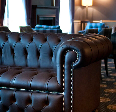 An image showing part of a comfy settee situated in the Bartle Hall Lounge Bar