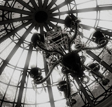 a black and white image showing a chandelier hanging from the ceiling from the Bartle Hall Country Hotel